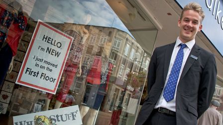 Walker and Ling, High Street - Sam Walker (manager) in new White Stuff/Joules area of the store, new