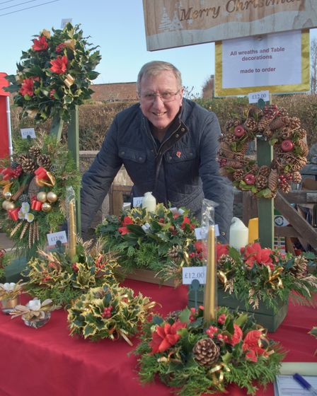 John Treharne with his Christmas wreaths and centre pieces. Picture: MARK ATHERTON
