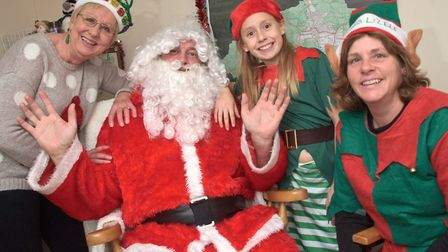 Santa and his helpers at Winscombe Community Association Christmas Fair. Picture: MARK ATHERTON