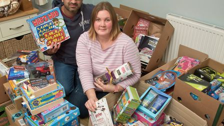 Sara and Khurm Arshad collecting gifts for Every Child Needs Christmas. Picture: MARK ATHERTON