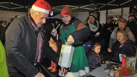 Winning prizes in the Christmas raffle. Picture: Jeremy Long