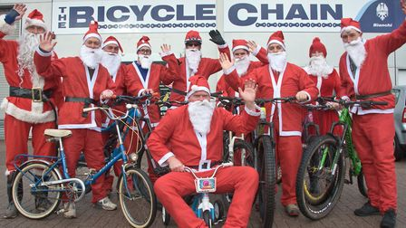 Cyclists biking through the Mendips dressed as Santa to raise money for their friend who was paralys