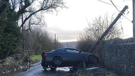 The car hit a power cable this morning. Picture: Will Gwyn