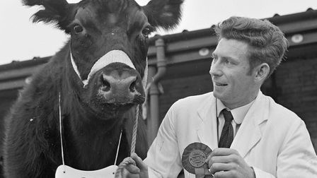 Weston's 68th Christmas Stock Show. Mr Francis Tucker with his prize winning Aberdeen Angus. Pi