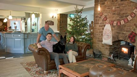 Landlady Sian Powell, bar manager Callum Powell and Jess the dog (head of security) with owner Gary