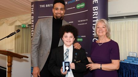 Nicholas Nikiforou with Ashley Banjo of Diversity and Dame Mary Perkins of Specsavers. Picture: Brit