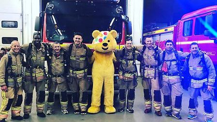 The firefighters at Avon Fire & Rescue pose with Pudsey The Bear after their 150 mile walk. Picture: