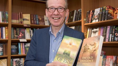 Justin Newland with copies of his books. Picture: Mark Atherton