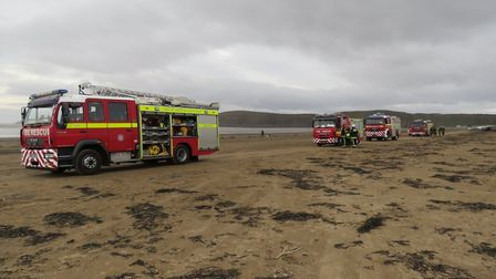 Firecrews worked with coastguard to remove a drum of an unknown and 'potentially hazardous substanc