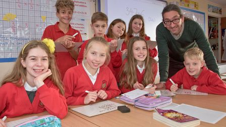 Year5/6 teacher Mr Max Khanna with pupils at Wraxall Primary School. They have been named the best p