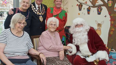 Santa and the Mayor and Mayoress visiting residents at Tilsley House, 14 - 16 Clarence Rd S, Weston.