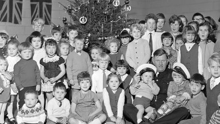 Mr Dave Spencer with children at the party which was held by ambulance drivers at the Drove Road dep