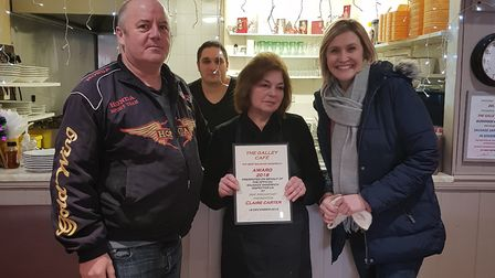 Mike Shaw presenting The Galley cafe with a certificate for best sausage sandwich in the UK.