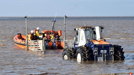 The crew being towed back after being stood down by the coastguard. Picture: Mike Lang/RNLI