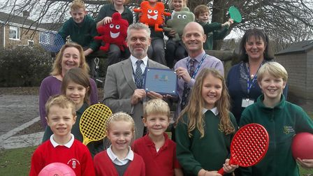 Shaun Cheesman receiving the plaque. Picture: Yatton Federated Schools