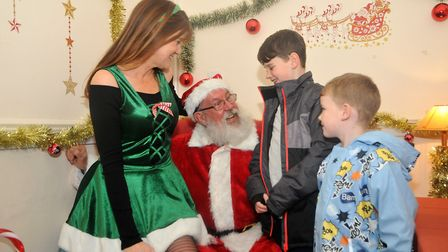 Brothers Leonh 10 and Logan 5 mee t Santa and his elf helperBig Worle's xmas fair (HW) 15,12,18