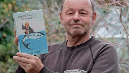 Author Alan Lathan with his new book, Angela Janny Jones and the Lost Norn. Picture: MARK ATHERTO
