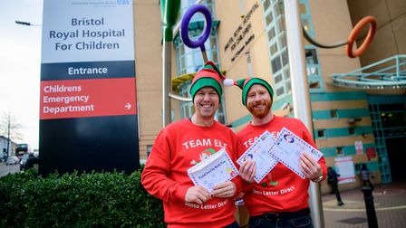 Jon and Jodie delivering letters from Santa to children in hospital.