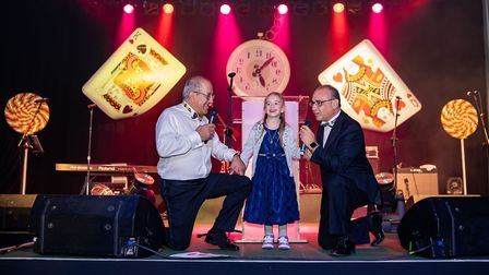 Kerry Michael and Theo Paphitis with Gracie who underwent life-changing surgery funded by AMCT.Pictu