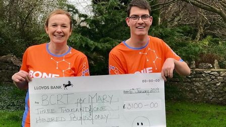 Ben Mager presenting the cheque to Sue Collard.