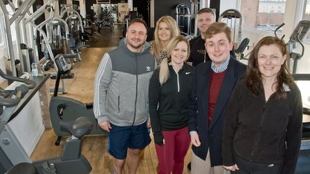 Caroline Ashworth and her son Dan have taken over the gym in North Street. Pictured with members of