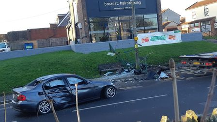 A silver BMW crashed into a bus stop which has been destroyed.Picture: Hollie Marie