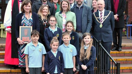 Bishop Peter Hancock presenting Flax Bourton Church of England Primary School with a commemorative p