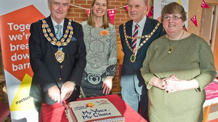 Mayor Mike Lyall and North Somerset chairman David Jolley cutting the cake with Lora Tanner a Leonar