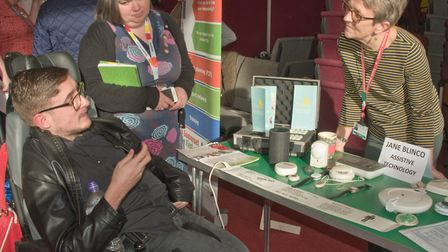 Jane Blinco demonstrating assistive technology at the My Voice, My Choice disability showcase. Pi