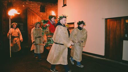 The Wassail Queen Evie-Mae Collings being escorted to the tree.Picture: Ollie Woolacott