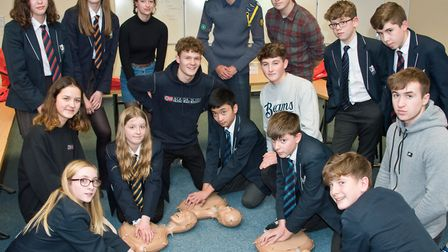 Sixth form students teaching DofE pupils CPR as part of their first aid training. Gordano School, Po