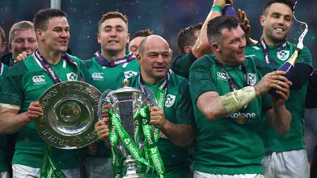 Ireland's Rory Best (centre) celebrates with the trophy after winning the Grand Slam during the 2018