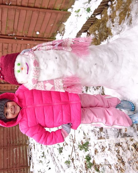 Jasmine Hall with her snowman. Picture: Krissy Hall