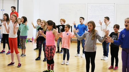 Children taking part on the singing and dancing workshops.