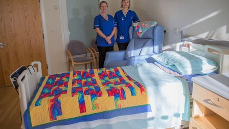 Hospice nurses pictured with one of the new beds.
