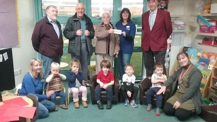Weston Mixed Skittles League presenting a cheque to Springboard Opportunity Group. Pi