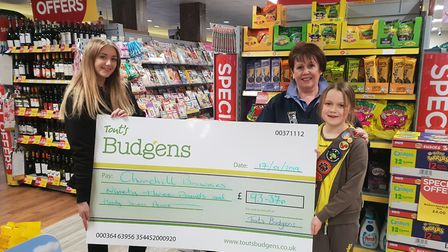 Churchill Brownies receiving a cheque from Langford Budgens.