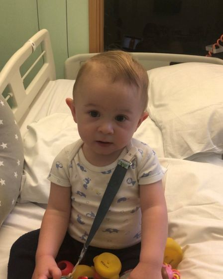 Emil can now move his limbs and sit up after intensive therapy.