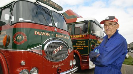 Gary Ball with some vintage trucks owned by his employer Harris & Miners.