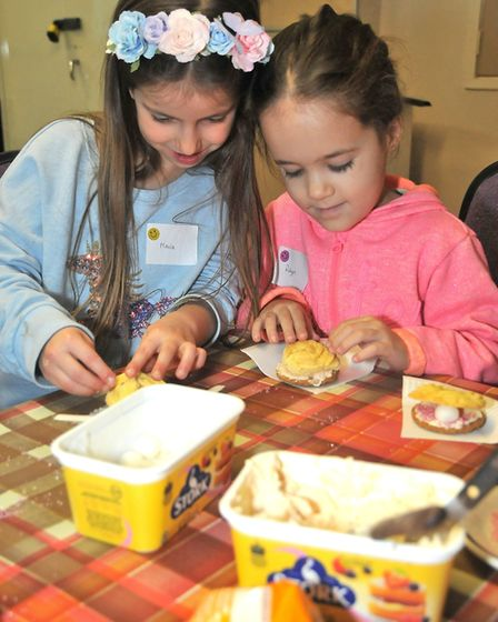 Robyn, aged five, and Maria, aged six, making pearl oyster biscuits at Milton Methodist Church's mes