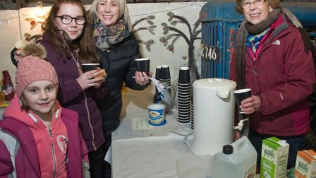 Wick St Lawrence Church Wassail at Icelton Farm, mulled cider and apple juice being served. Pictu