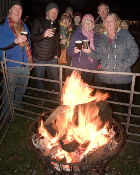 Warm cider and a warm fire at Wick St Lawrence Church Wassail. Picture: MARK ATHERTON