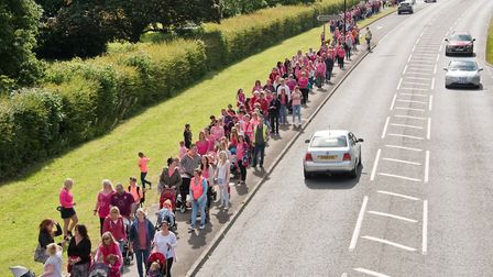 Locking people and supporters walking along the A371 in honour of young road accident victim April R