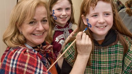 Pre-historic History Day at Weston Museum. Young Iron Age Warriors getting their wode war paint.