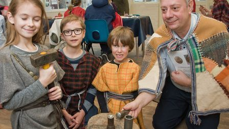 Pre-historic History Day at Weston Museum. Stamping iron age coins. Picture: MARK ATHERTON