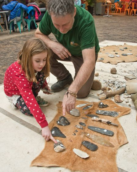 Pre-historic History Day at Weston Museum. Bethan with flint knapper Karl Lee from Primitive Technol