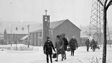 Coranation estate residents picking their way through the snow near, St. Barnabas Church. Pictur