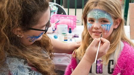 Family fun day at the Castle Batch Community Centre in Worle. Lottie getting her face painted by Dev