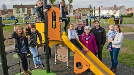 Youngsters enjoying the new play equipment watched by Weston Mayor Cllr Mike Lyall and Mayoress Marg