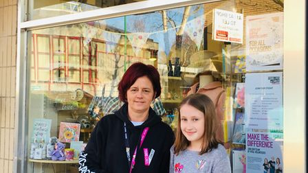 Backwell Junior School student Georgia O Keefe with CLIC Sargent's Nailsea store deputy manager Man